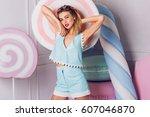 summer positive portrait of... | Shutterstock . vector #607046870