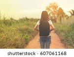 young traveler woman walking... | Shutterstock . vector #607061168