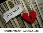 Small photo of Broken heart with Alimony paper note on money
