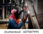 asian welder at work with... | Shutterstock . vector #607087994