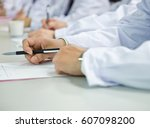 group of doctors writing at a... | Shutterstock . vector #607098200