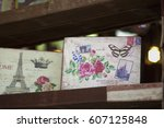 Small photo of RAATCHA-BURY, THAILAND- FEB 19:An unidentified souvenir shop is decorated with wooden boxes painted with various famous places on display on February 19,2017 at Suan-Phueng in Raatcha-bury, Thailand.