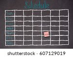 Small photo of Freehand white chalk doodle sketch of blank monthly grid timetable schedule on black chalkboard background: Hand drawn study plan on blackboard with weekly date written in colorful pastel color