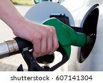 woman filling the fuel in the... | Shutterstock . vector #607141304