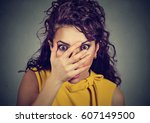 scared young woman covering her ... | Shutterstock . vector #607149500