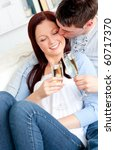 attractive couple drinking... | Shutterstock . vector #60717370