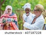 caucasian woman doctor holding... | Shutterstock . vector #607187228