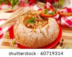 traditional polish tripe soup with tomato and  vegetables in bread bowl - stock photo