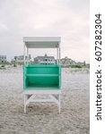 life guard tower on a beach at... | Shutterstock . vector #607282304