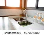 interior of a modern kitchen... | Shutterstock . vector #607307300