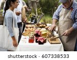 people at healthy local food... | Shutterstock . vector #607338533