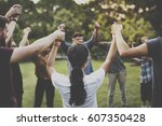 group of people holding hand... | Shutterstock . vector #607350428
