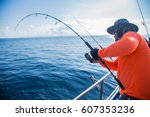 sea fishing with spinning | Shutterstock . vector #607353236