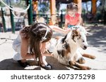 girl is grooming a goat with a... | Shutterstock . vector #607375298