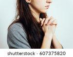 prayer. female. | Shutterstock . vector #607375820