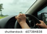 hand is holding the steering... | Shutterstock . vector #607384838