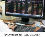 businessman trading stocks.... | Shutterstock . vector #607386464