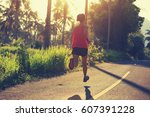 young fitness woman running at... | Shutterstock . vector #607391228