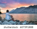 beautiful sunset over lake... | Shutterstock . vector #607391888