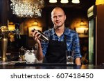 barman at work pouring hard... | Shutterstock . vector #607418450
