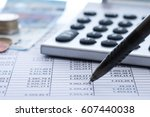 pencil and calculator with... | Shutterstock . vector #607440038