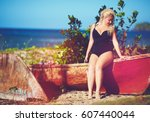 plus size young woman sitting... | Shutterstock . vector #607440044
