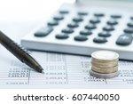 calculator with balance sheet ... | Shutterstock . vector #607440050