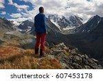 young sportive hiker trekking... | Shutterstock . vector #607453178