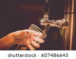 image of a waiter pouring... | Shutterstock . vector #607486643