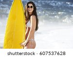 smiling surfer girl in shades... | Shutterstock . vector #607537628