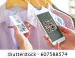 woman scanning qr code from a... | Shutterstock . vector #607588574