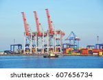 tugboat and crane in harbor... | Shutterstock . vector #607656734