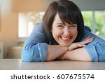 portrait of smiling 50 year old ...   Shutterstock . vector #607675574