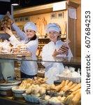 beautiful women offering bread... | Shutterstock . vector #607684253