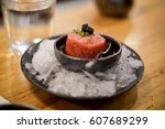 beef tartar with caviar topping ... | Shutterstock . vector #607689299