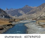 blue marsyangdi river. autumn... | Shutterstock . vector #607696910