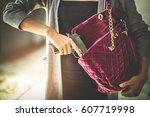 woman pulls a gun from her... | Shutterstock . vector #607719998