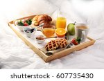 breakfast in bed with fruits... | Shutterstock . vector #607735430