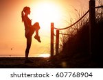 woman performs stretching... | Shutterstock . vector #607768904