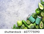 green detox smoothie on a grey... | Shutterstock . vector #607775090