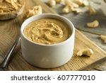 homemade cashew peanut butter... | Shutterstock . vector #607777010