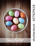 colorful easter eggs on rustic... | Shutterstock . vector #607829618