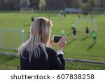 mother watching or taking photo ... | Shutterstock . vector #607838258