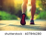 young fitness woman running on... | Shutterstock . vector #607846280