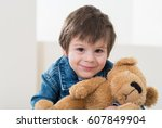 little boy sitting on the... | Shutterstock . vector #607849904
