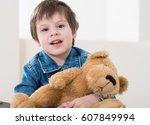 little boy sitting on the... | Shutterstock . vector #607849994