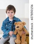little boy sitting on the... | Shutterstock . vector #607850156