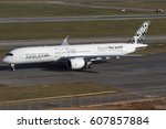 Small photo of Airbus a350 900 test airplane of Airbus, with airbus livery in Guarulhos International Airport, Sao Paulo, Brazil - august 07, 2014