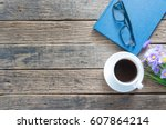 coffee cup and book with wooden ... | Shutterstock . vector #607864214