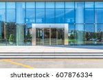 clean road front of office... | Shutterstock . vector #607876334